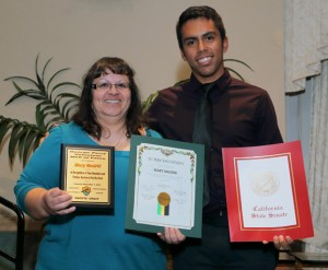 Mary Madrid (pictured with her son, Tass Duarte) was inducted into the George Perry Volunteer Hall of Fame.